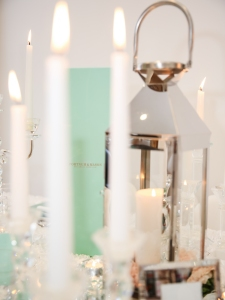 Luxe glass and chrome candle lit details