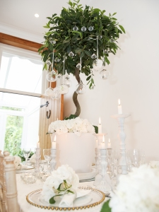 A bomb of white hydrangea makes a gorgeous place setting detail.