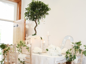 Pure white, natural greenery and candlelit styling.