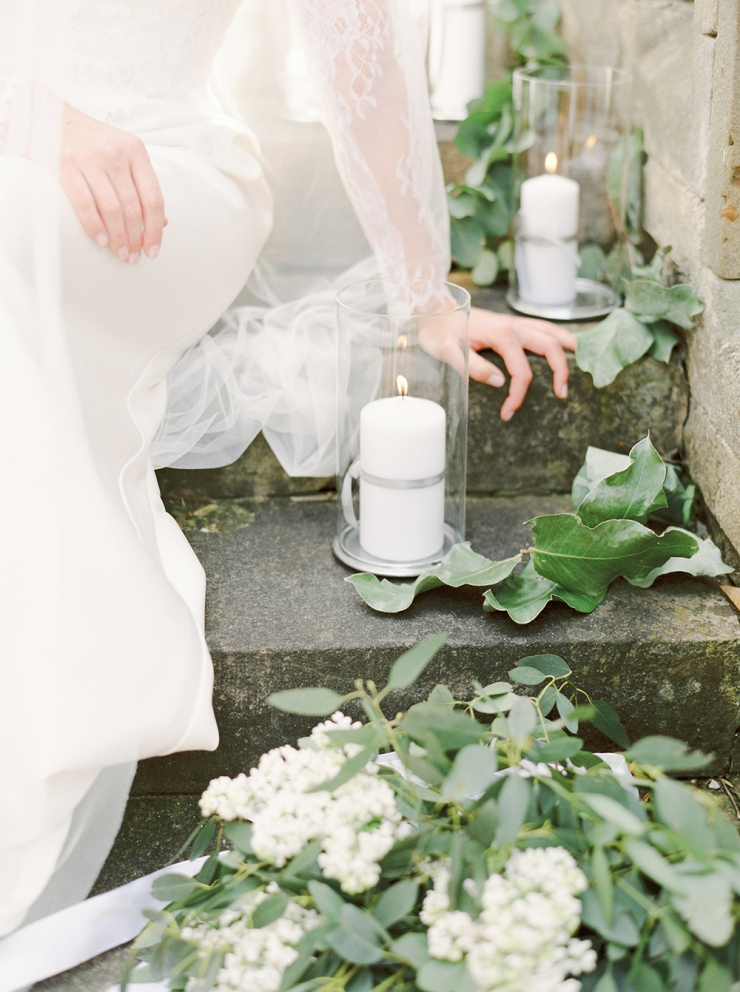 outdoor wedding styling,photographs on the step,candles outside,